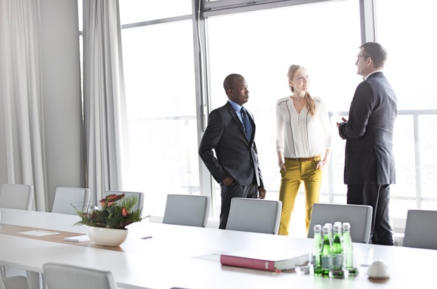 three office workers in a meeting room