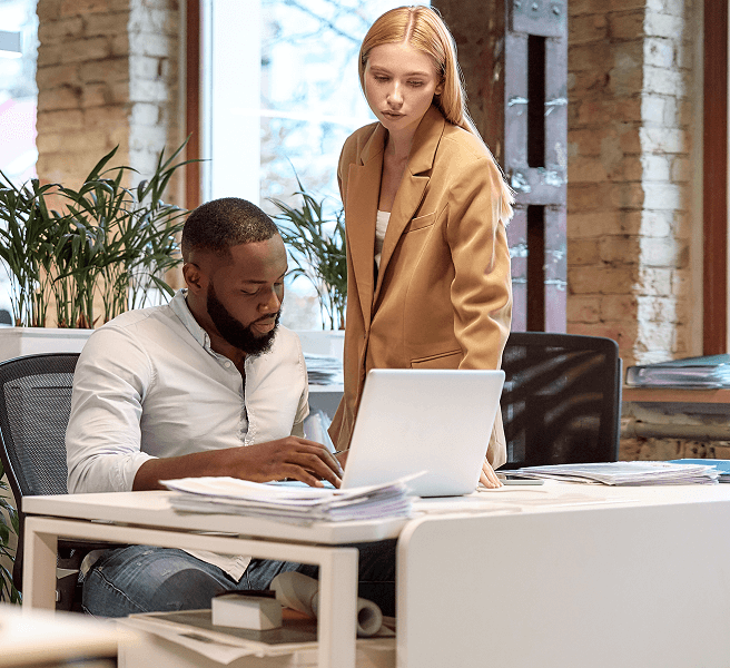 A man and woman working in an office