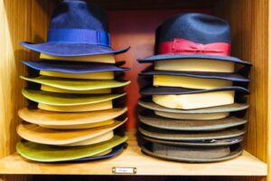 A stack of hats on a shelf