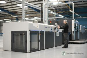 A Transcend Packaging employee using a console to set up one of its packaging machines